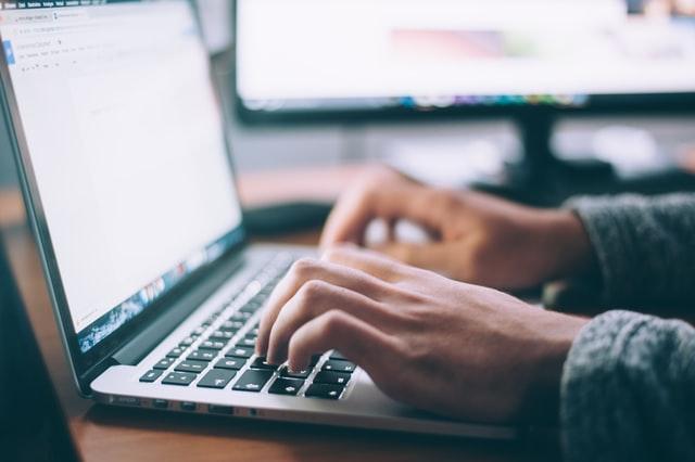 Writing an artist statement on a computer